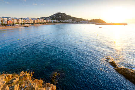 Blanes city and beach from Sa Palomera rock at morning in Spain