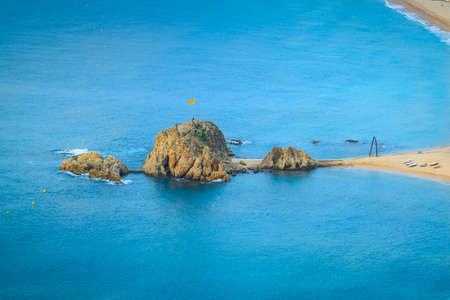 Sa Palomera rock and beach of Blanes city in Spain