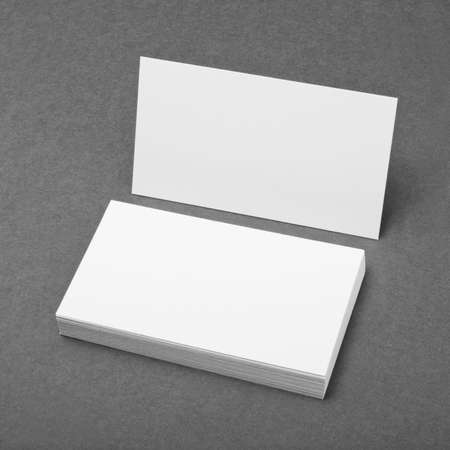 note card: blank business cards on grey background Stock Photo