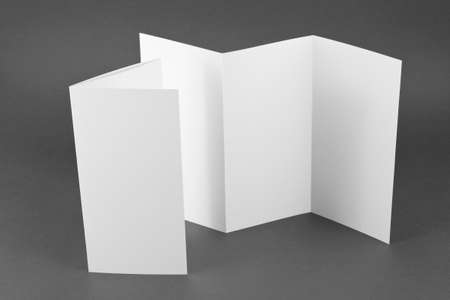 Blank folding page booklet on gray background