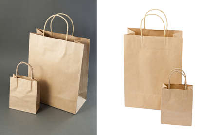 Empty Shopping Bag from craft paper, Recycled paper shopping bag on gray and white background photo