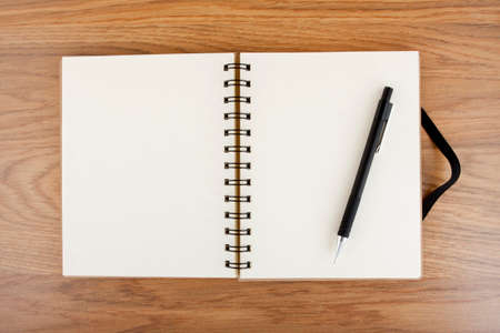 elastic band: Opened notebook with black elastic band and pencil on a table Stock Photo