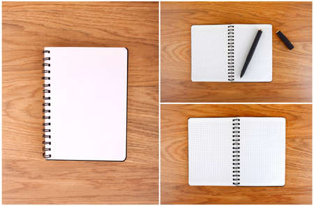 Notepad with a spiral binding and checkered sheets on a wooden background. A set of open notebooks photo