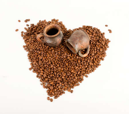Empty ceramic cup end Heart of coffee beans Stock Photo