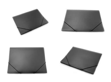 elastic: black plastic folders with elastic bands, isolated on white background Stock Photo