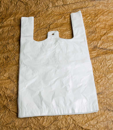 White bags with handle on brown design paper photo