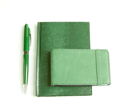 Corporate identity templates: green notepad, cards holder and pen. Isolated on white background photo