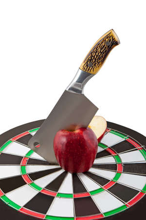 knife cuts red apple in the centre of target photo