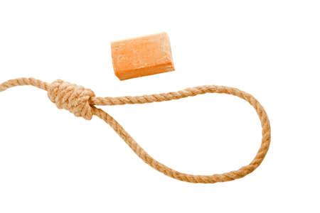 Rope with hangmans noose and soap isolated on white background photo