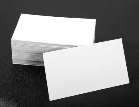 blank business cards on a black leather background