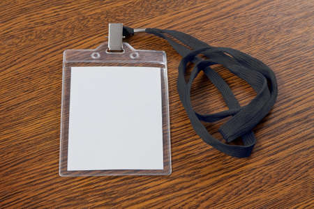 neckband: Blank badge with neckband on a wooden background