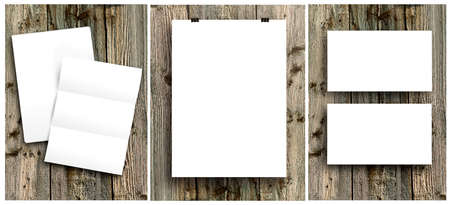 paper sheets: blank white folding paper flyer on a wooden background, identity design, corporate templates, company style, set of booklets Stock Photo