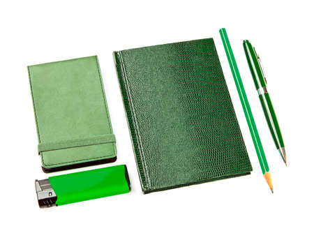 Green set of stationery isolated on white background photo
