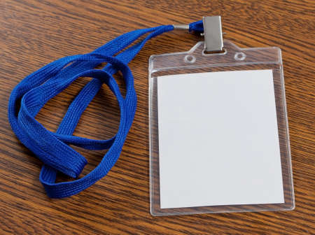 neckband: Blank badge with neckband on wooden background