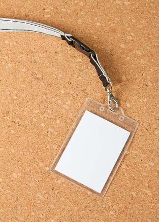 Blank badge with neckband on corkboard background Stok Fotoğraf