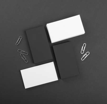 identity design, corporate templates, company style, black and whote business cards on a black background Reklamní fotografie