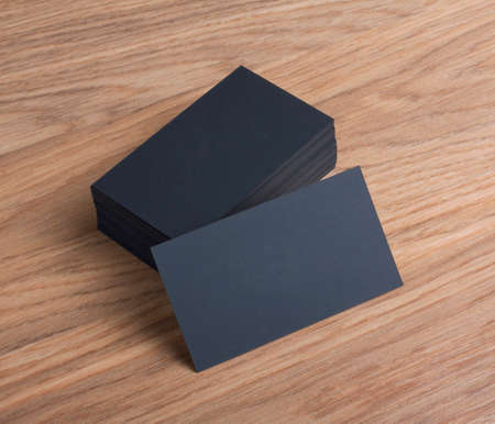 business cards: identity design, corporate templates, company style, blank business cards on a wooden background