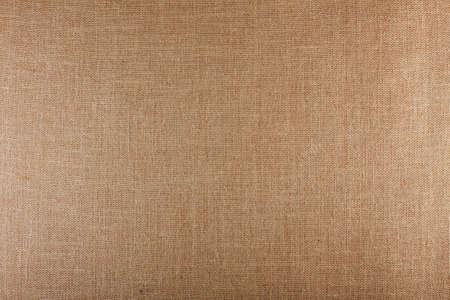 Closeup of brown textured surface, burlap texture background