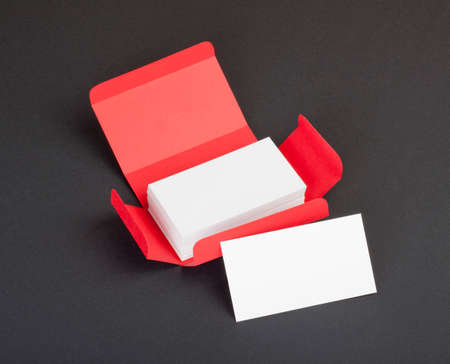 White business cards in the red box