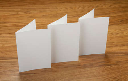 note booklet: blank white folding paper flyers Stock Photo