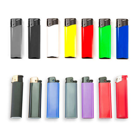 Set of colored lighters on white background photo