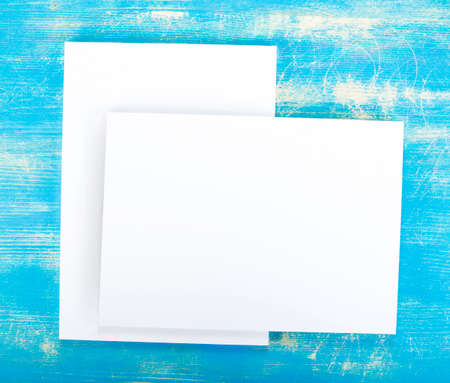 replace: Blank flyer poster on wooden background to replace your design