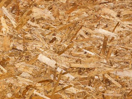 Fiberboard. Compressed light brown wooden texture