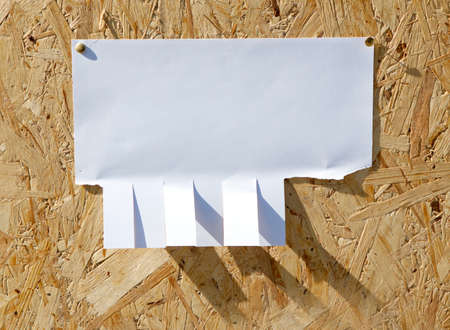 tearaway: Ad with clips on wooden background Stock Photo