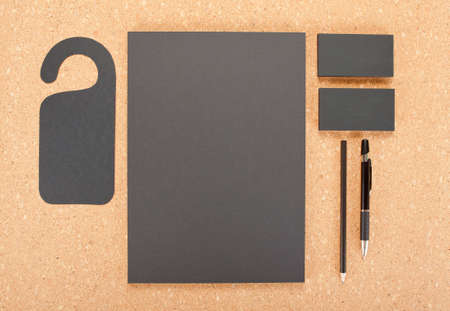 consist: Blank Stationery on cork board. Consist of Business cards, A4 letterheads, pen and pencil