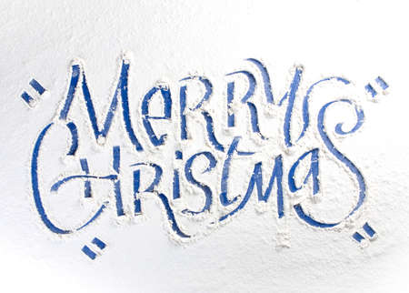Written words Merry christmas on a snow