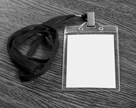 neckband: Blank badge with neckband over wooden background Stock Photo