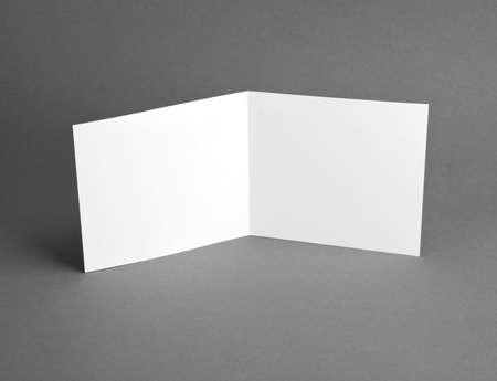 White empty open card on grey to replace your design