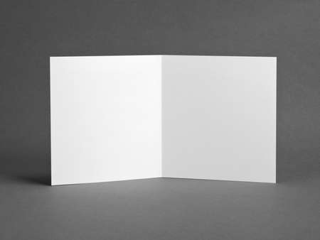White empty  card on grey to replace your design Reklamní fotografie