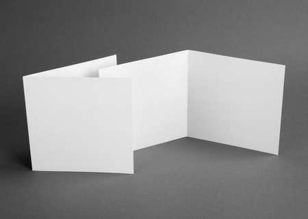 White empty  card on grey to replace your design Stock Photo