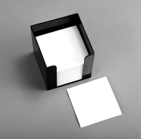 Black leather memo pad holder with blank white memo paper