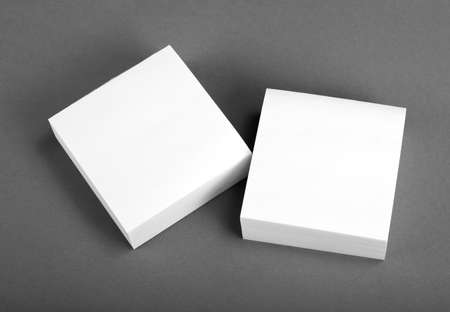 Collection of white note papers on gray background