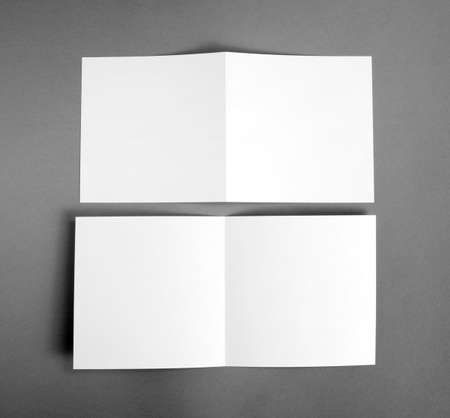 handouts: White empty  card on grey to replace your design Stock Photo