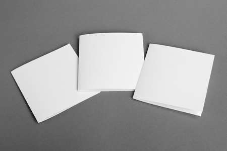 handouts: White empty  cards on grey to replace your design. Stock Photo