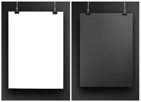white poster: Black and white poster on a rope. Sheet of paper hangs on two black binder clips Stock Photo
