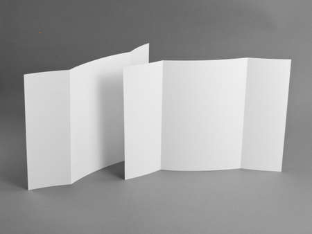 handouts: Blank gate fold brochure on grey to replace your design