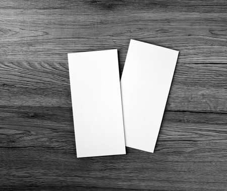 replace: Blank flyer over wooden background to replace your design