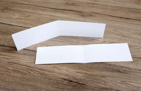 White empty card on wooden background to replace your design