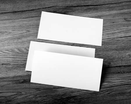 note booklet: Blank flyer over wooden background to replace your design
