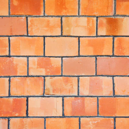 grungy: A grungy red brick wall texture, background