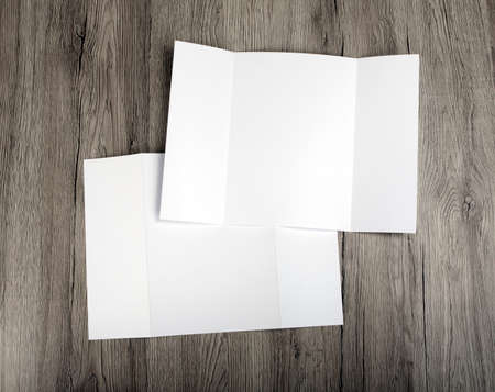 Blank gate fold brochure on wooden background to replace your design Stock Photo