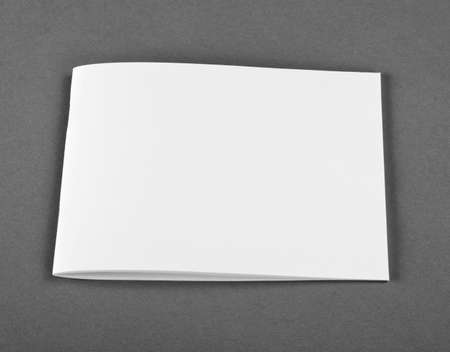 Blank closed magazine, catalog, brochure, magazines, book on gray background. Top view