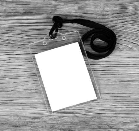 neckband: Blank badge with neckband on wooden background. Name id card with cord