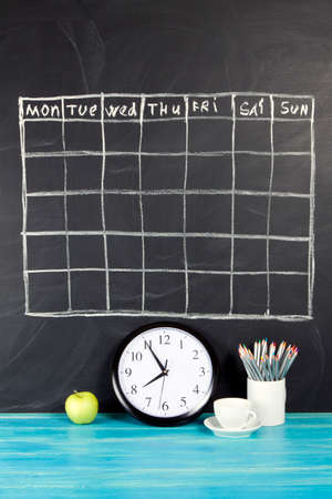 Grid timetable schedule on black chalkboard background Stock Photo