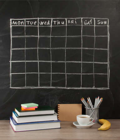 Grid timetable schedule on black chalkboard background Stock Photo - 84942563