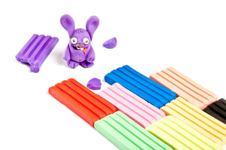 Childrens toy made from plasticine on white background Stock Photo